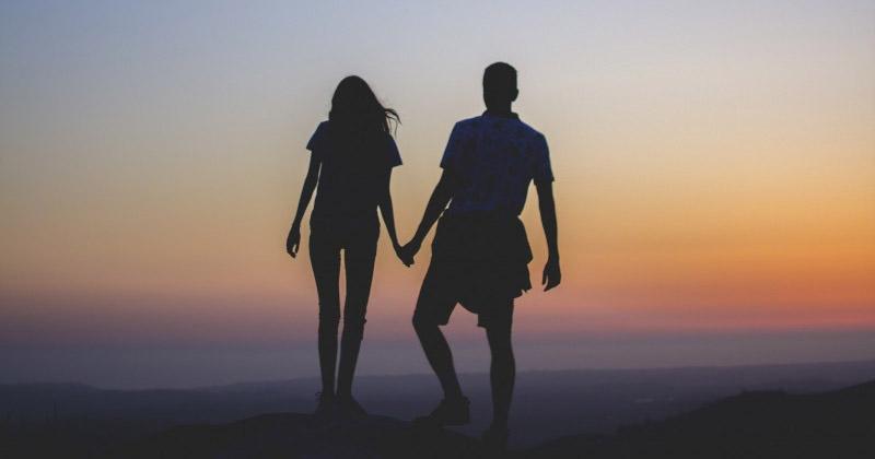 Couple enjoying a sunset together